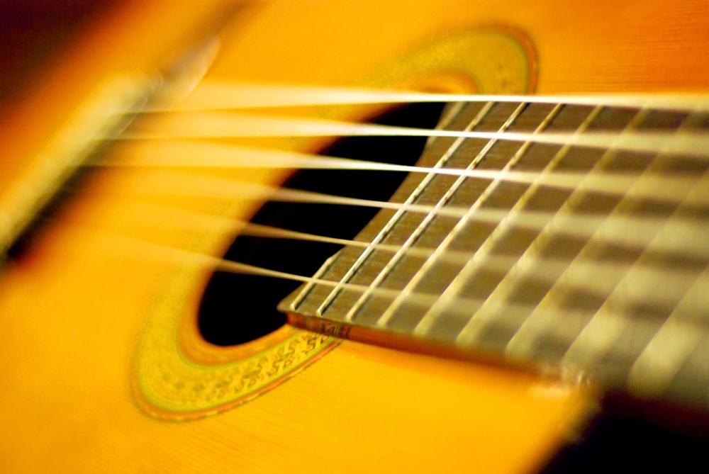 کاهش اکشن گیتار